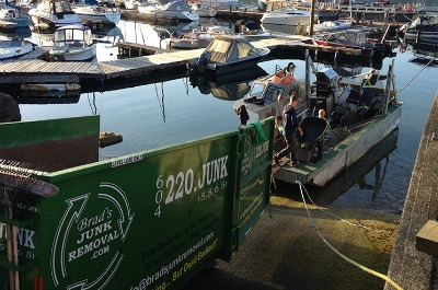 Loading up a dumpster by the water, Vancouver BC