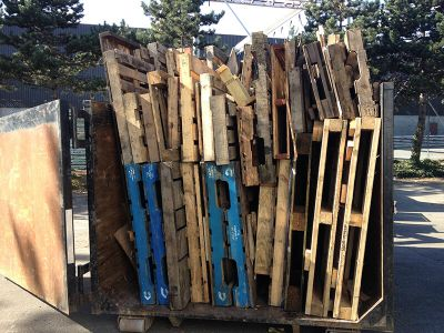 dumpster bin filled with pallets