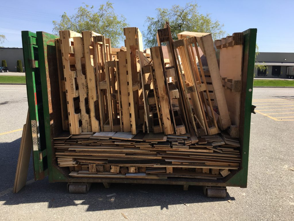 neatly stacked pallets in junk removal bin annacis island
