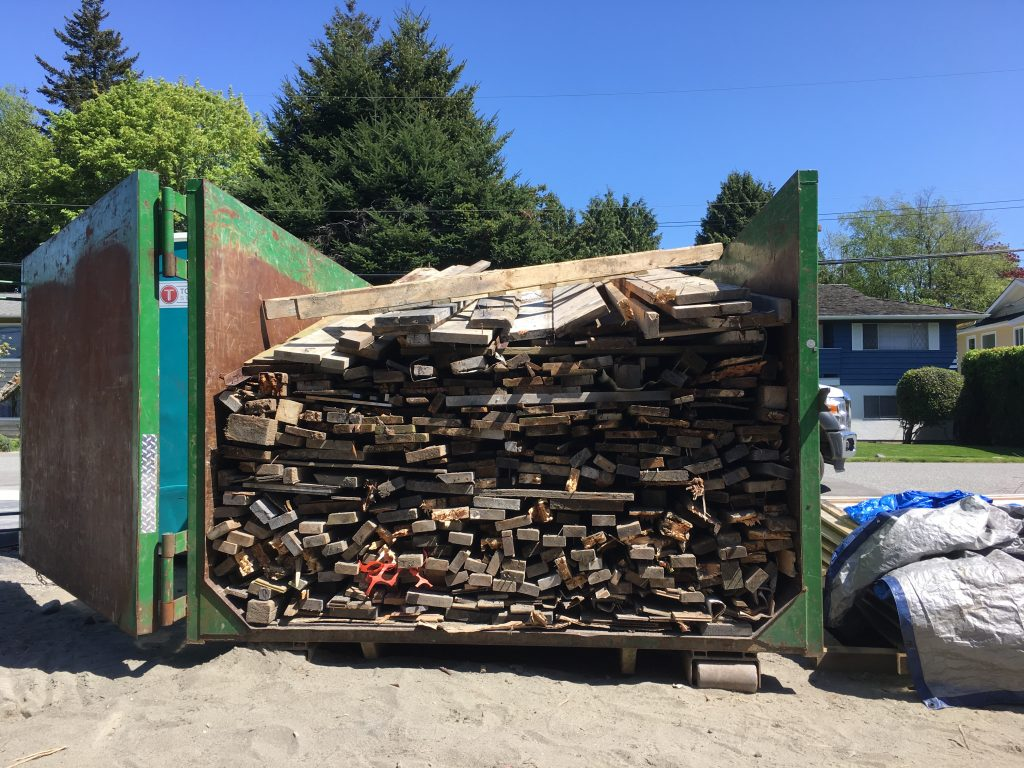 neatly stacked wood in bin