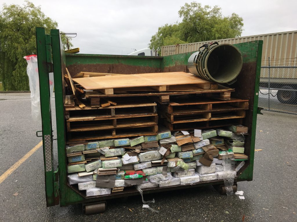 pallets and construction trash in bin